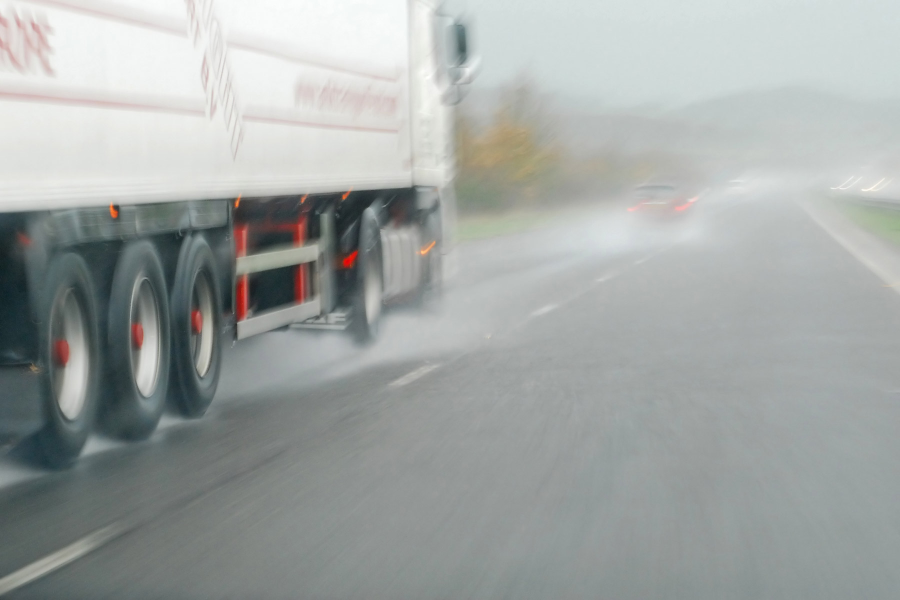 Lorry driving on a wet road